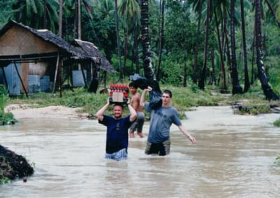 Helping locals after flood in Ko Pha Ngan